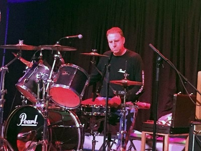 Pat Caine, CIO and rock drummer